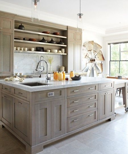 Gray stained cabinets, sink in island.  Connie Braemer Design;