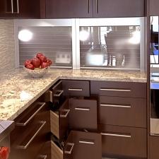 Glass tambour and corner drawers